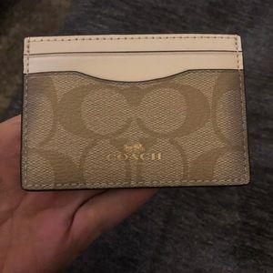 COACH Credit card holder.